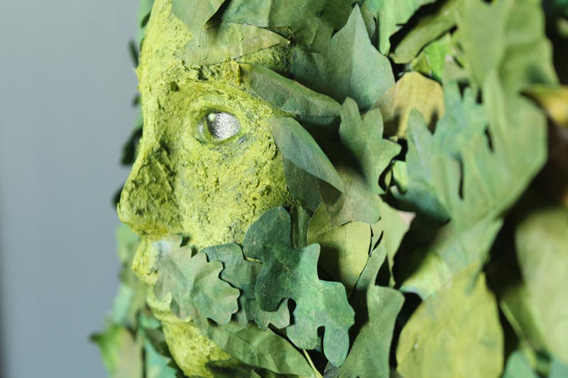 The face amongst the leave. Mixed media of a Green Woman at kathycassell.com