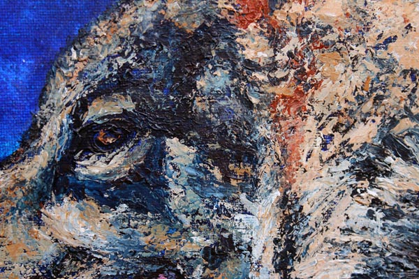 Detail of texture in a wolf painting done with a knife in acrylic