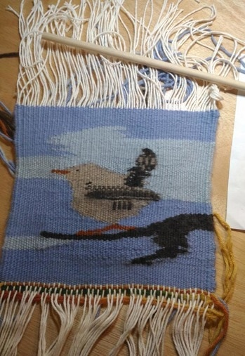 The bird tapestry cut from the loom