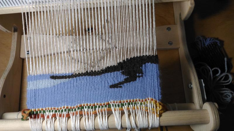 The tapestry started on the loom
