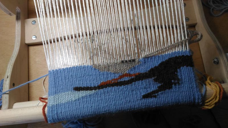 Advancing the tapestry on the front rod